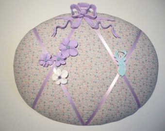 Floral collage with a purple bow made of polymer clay