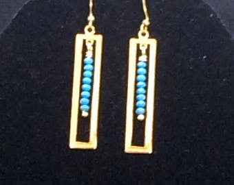 Shic geometric earrings.  Stunning mix of antiqued brass up-cycled metal earrings highlighted in teal swarovski earrings.