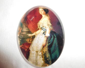 A glass cabochon representing a marquise.