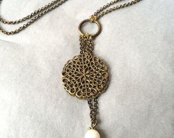 Brass necklace with a white freshwater pearl