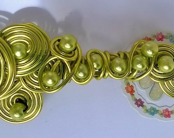Pretty Barrettes yarn beads and aluminum