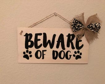 Beware of dog sign with burlap bow