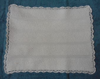 top of white cotton baby pram blanket