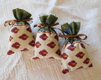 Sold by three (ecru and Burgundy) handmade Lavender sachets