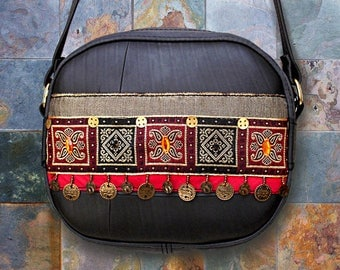 Small ethnic shoulder bag in inner tube recycled and Indian Red/caramel and black ribbon.
