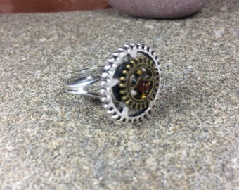 Steampunk ring multisize with silver and bronze colour metal cogs and red glass bead centre