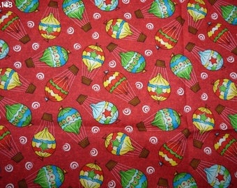 C143 balloon fabric on red coupon 35x40cm