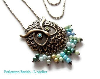 """""""The OWL wall eyes..."""" bronze metal necklace, shades of green and blue glass beads"""