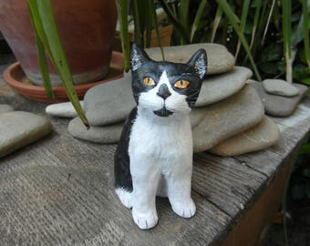 Black and white cat made of clay self-hardening for decoration