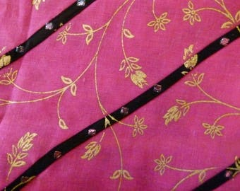 Pink hand stitched band is black cotton fabric and fleur de lis gold