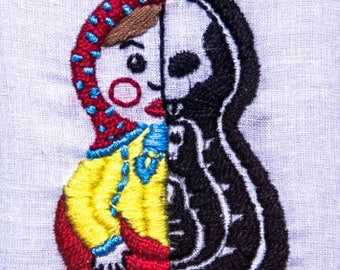 Matryoshka doll. Dance Macabre embroidery.