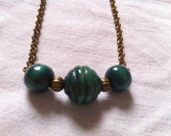Bronze necklace with green wooden beads