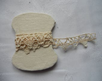 Year 1920 on cardboard with linen lace