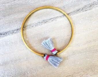 Raw brass with gray edging tassels fuscia pink