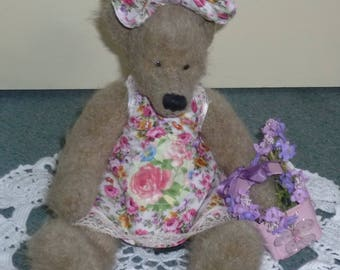 Flower Valentine lovely Teddy bear wearing a dress and hat