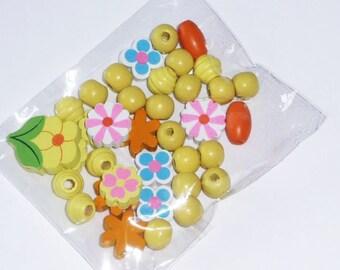 Set of 36 yellow wooden beads, orange... (flowers)