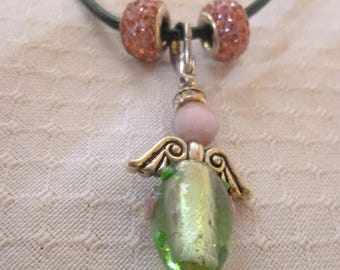 Beautiful angel Necklace in the colours green and pink.