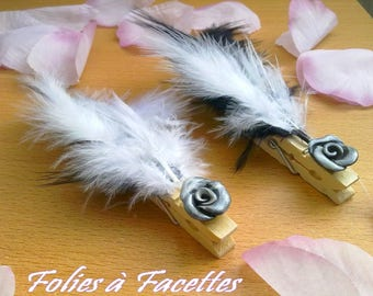 10 squares wooden pin marks and black and white feathers