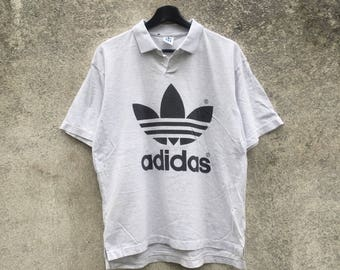ADIDAS vintage 90s Adidas Trefoil big logo large back side spellout collar shirt