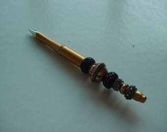 pen black and gold jewelry