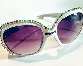 Women's oversize white sunglasses with green and purple rhinestone crystals