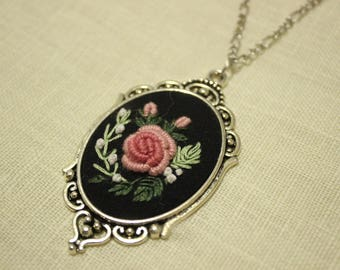 Pendant with embroidery
