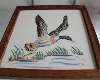 Decorative tile with wooden frame, flying duck