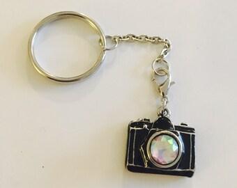 Black metal 80s-style camera key chain