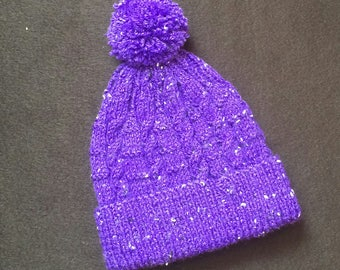 Hand knitted child's bobble hat
