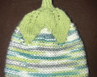 Hand knitted infant hat in green and teal ombré