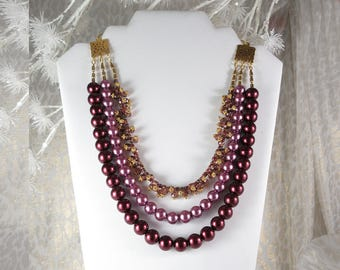 """Triple Strand Purple and Burgundy Pearls Featuring Gold Finish Accents.  22"""" Long. Gold finish Lobster Claw Clasp. Nickle Free"""