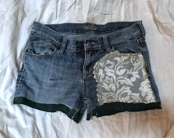 Upcycled shorts with lace and green trim