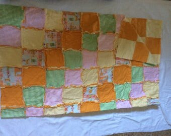 Large flannel rag quilt.
