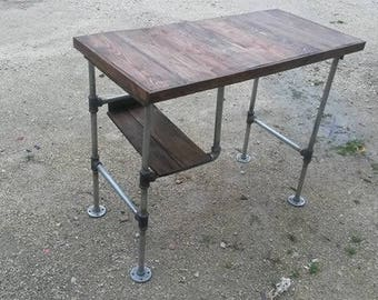 Industrial style desk with reclaimed pallet wood and welded steel legs