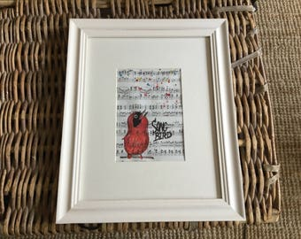 Hand drawn song bird on antique music paper.