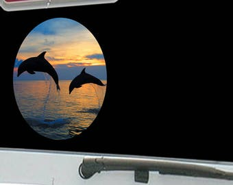 Two Dolphins Jumping Sunset Sunrise Behind Sky