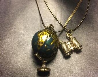 Rotating globe double necklace