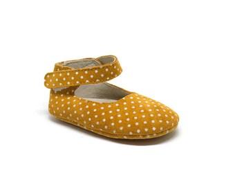 Mary Jane yellow polka dot shoes.
