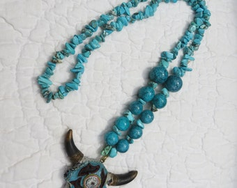 Turquoise green necklace with cow skull