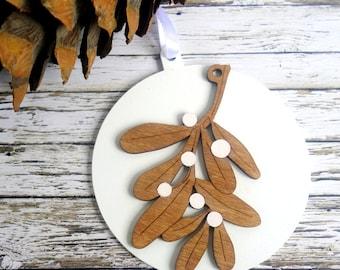 Mistletoe modern Christmas ornament, white wood bauble. Natural dark wood, hand-painted. Fun, natural, tree decoration.