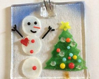 Happy snowman and tree