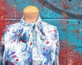 Vintage 1970s Sky Blue Floral Ascot Neck Blouse (Size Medium/Large)
