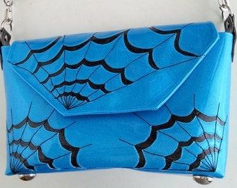 Metalflake sparkle vinyl small handbag light blue with black spiderwebs and strap