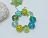 Tealy dots, greener - Colorful artisan lampwork beads by Loupiac