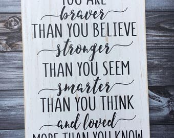 You are braver than you believe stronger than you seem smarter than you think and loved more than you know   wood sign   sign   Style# HM194