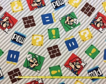 """NEW Mario Bros on cotton lycra knit fabric 96/4 58"""" wide."""