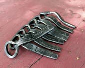 Eight hand-forged bottle openers for Karly