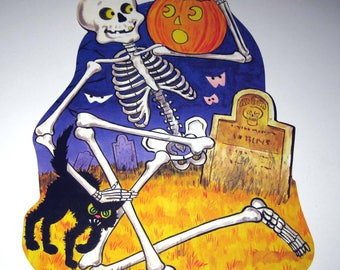 Vintage Halloween Die Cut Decoration with Skeleton in Graveyard with Cat and Jack O Lantern NOS