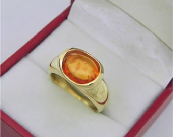AAAA Orange Spessartite Garnet 3.5 carats  10.4x8.1mm in 14K Yellow gold bezel set ring.  254