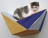 Cat shelf geometric wall bed in mustard and royal with blue and white stripes